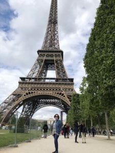 woman posing in front of Eiffel tower