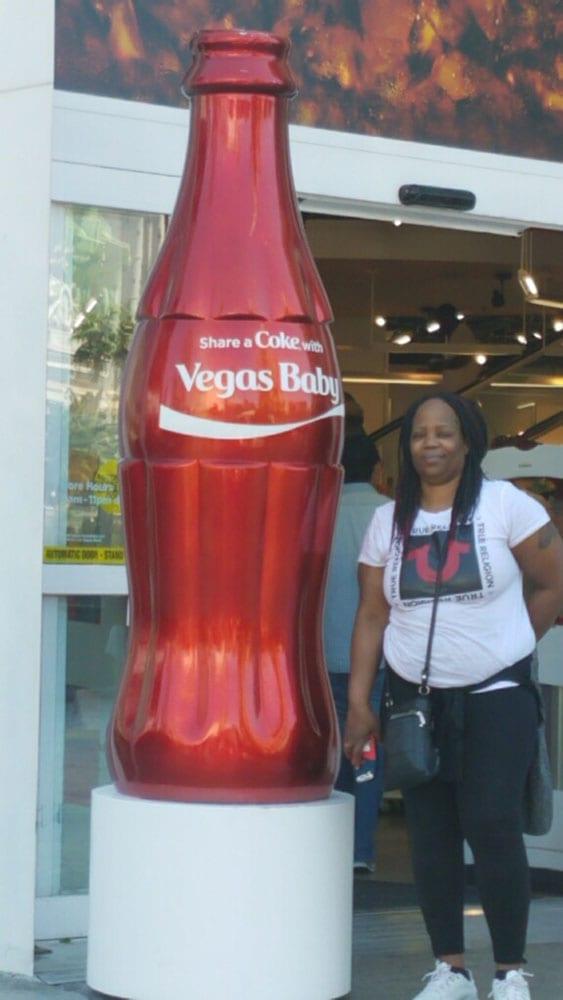 Crystal W posing with Vegas Coke bottle statue