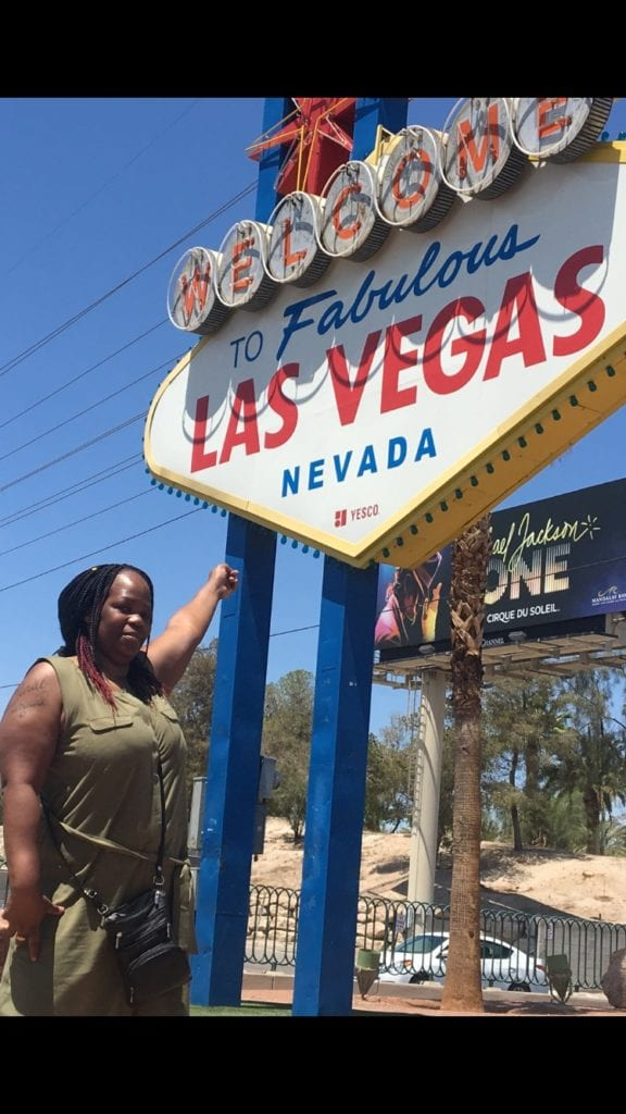 Crystal W posing in front of Vegas sign