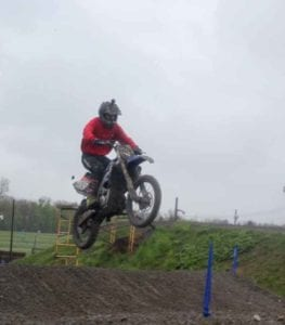 man riding dirtbike on a jump